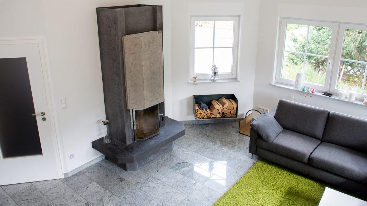 Wohnzimmer Waende smooth Kamin Betonoptik Referenz