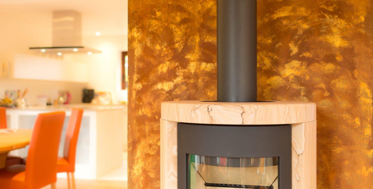 Rostoptik mit Gold Gestaltung Kaminwand Hannover Wedemark Burgwedel